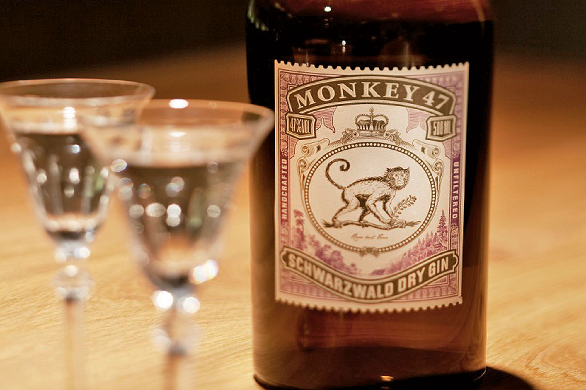 A bottle Monkey 47 Schwarzwald Dry Gin with two glasses